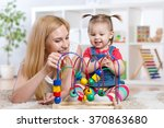 happy kid girl and mom playing... | Shutterstock . vector #370863680
