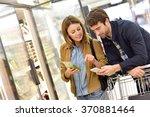 couple in supermarket reading... | Shutterstock . vector #370881464
