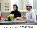 young emirati arab couple... | Shutterstock . vector #370889264