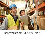 store manager with warehouseman ... | Shutterstock . vector #370891454