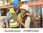 store manager with warehouseman ... | Shutterstock . vector #370891460