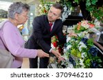 woman choosing flowers | Shutterstock . vector #370946210