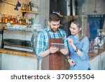 smiling handsome waiter holding ... | Shutterstock . vector #370955504