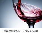 Small photo of stream of wine being pouring into a glass closeup, wine, splashing, splash
