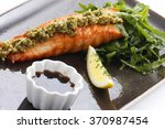 grilled salmon on a plate with... | Shutterstock . vector #370987454