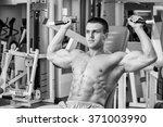 athlete in the gym making... | Shutterstock . vector #371003990