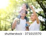 family relaxing in the park   Shutterstock . vector #371015570