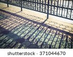 Wrought Iron Fence And Shadow.