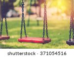 empty chain swing in playground.... | Shutterstock . vector #371054516