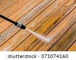 power washing. wooden deck... | Shutterstock . vector #371074160