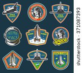 Set of vintage space and astronaut badges, emblems, logos and labels. Colored on dark background.