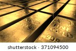 Stock photo close up view of shiny gold bars stacked up in perfect rows with ambient light reflected from its 371094500