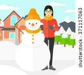 woman posing near snowman. | Shutterstock .eps vector #371117063