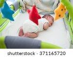 newborn baby in bed | Shutterstock . vector #371165720