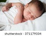 newborn baby in first week of... | Shutterstock . vector #371179334