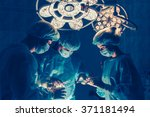surgeons team working with... | Shutterstock . vector #371181494