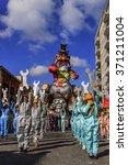 Small photo of Putignano,Apulia,Italy - February 15, 2015: carnival floats, giant paper mache. Allegorical float of Ilva industry.