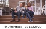 beautiful family looking at... | Shutterstock . vector #371222920
