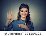 young woman making a promise | Shutterstock . vector #371264128