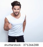 handsome young and fit man... | Shutterstock . vector #371266288
