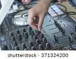 woman hands on dj equipment... | Shutterstock . vector #371324200
