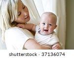 mother holding happy seven... | Shutterstock . vector #37136074
