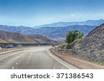 a road between mountains of... | Shutterstock . vector #371386543