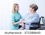 nurse caring about elder woman... | Shutterstock . vector #371388640