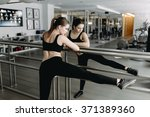 woman stretching her leg at the ... | Shutterstock . vector #371389360