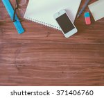 table with phone  paper and... | Shutterstock . vector #371406760