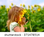 happy little girl smelling a... | Shutterstock . vector #371478514