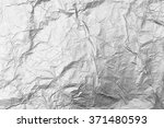 silver crumpled foil background | Shutterstock . vector #371480593