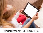 mother and daughter looking at... | Shutterstock . vector #371502313