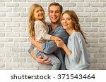 Beautiful Young Family Hugging...