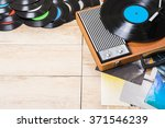 gramophone with a vinyl record... | Shutterstock . vector #371546239
