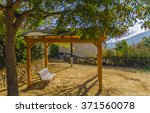 pergola under a tree with a... | Shutterstock . vector #371560078