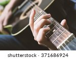 playing black classic guitar... | Shutterstock . vector #371686924