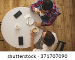 young couple drinking coffee.... | Shutterstock . vector #371707090