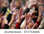 raised up a human hands at the... | Shutterstock . vector #371716606
