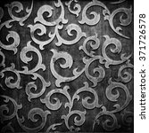 black carved ornament on wooden ... | Shutterstock . vector #371726578