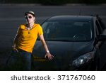 a rich guy and a car  cool dude   Shutterstock . vector #371767060
