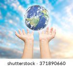 human hand holding earth planet.... | Shutterstock . vector #371890660