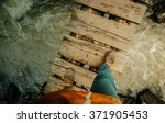 man's legs on an old wooden... | Shutterstock . vector #371905453