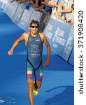 Small photo of STOCKHOLM - AUG 23, 2015: Triathlete Allesandro Fabian (ITA) running at the finish at the finish at the Men's ITU World Triathlon series event August 23, 2015 in Stockholm, Sweden