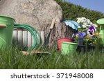 garden tools on grass in yard | Shutterstock . vector #371948008