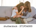 mother comforting her teenage... | Shutterstock . vector #371956000