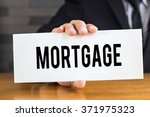mortgage  message on white card ... | Shutterstock . vector #371975323