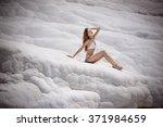 girl in white bikini sunbathing ... | Shutterstock . vector #371984659