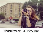 tourists take pictures on her... | Shutterstock . vector #371997400