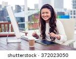 smiling asian woman using... | Shutterstock . vector #372023050
